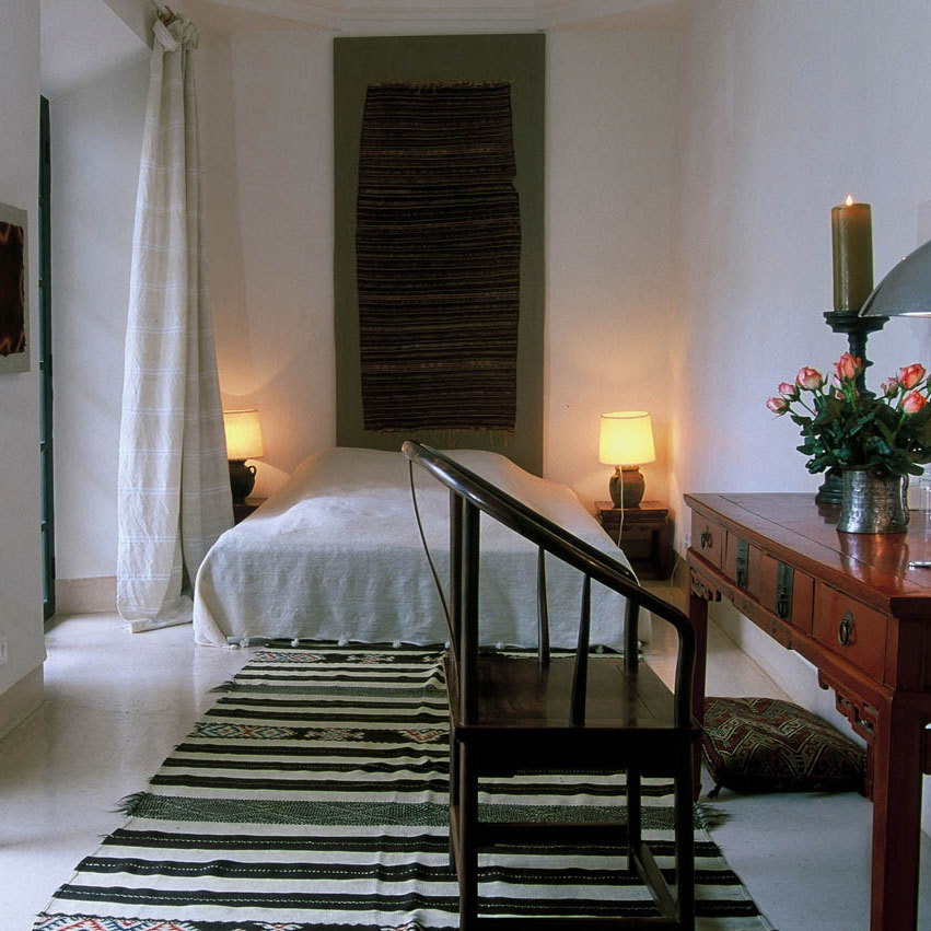     The bedroom with gallery doors to balcony