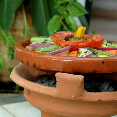 Tajine cooked in open air
